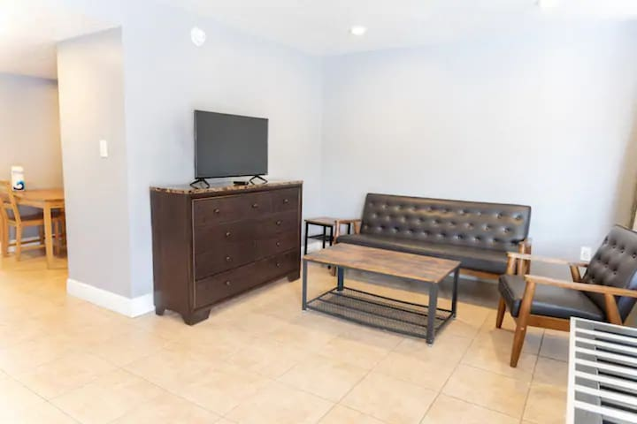 Spacious and comfortable living room with pull-down Murphy bed