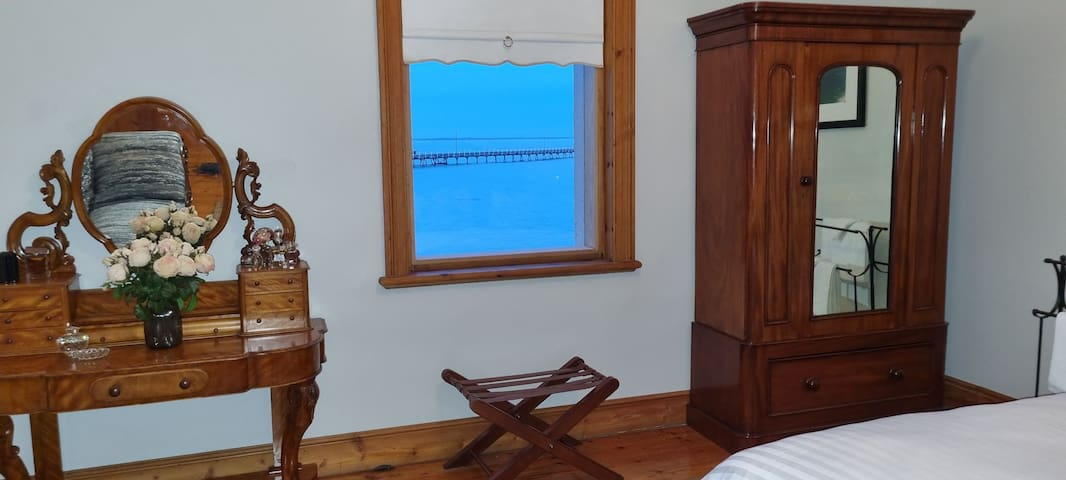 Bedroom 1 offers an ocean view from three windows.  There is  nothing quite like the lullaby of ocean sounds at night or in the day