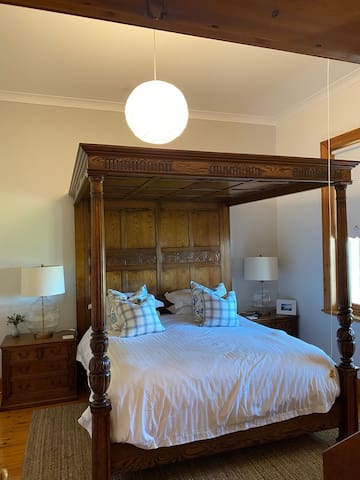 Sleep like royalty in this King four-poster bed with a view to the jetty and beach.  This large room also contains a single bed and bureau desk and chair.   Bedroom 3