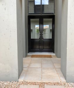 Flat entrance with some loose stones