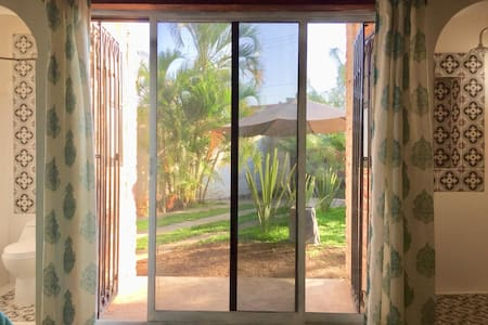 This is 2.00 mts window to get in and out the bedroom. In the left side is the toilet and in the right side the shower.