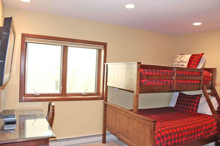 Guest Room 4: Twin top bunk, Double bed lower bunk, closet, TV and en-suite bathroom.