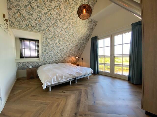 Slaapkamer boven aan waterkant