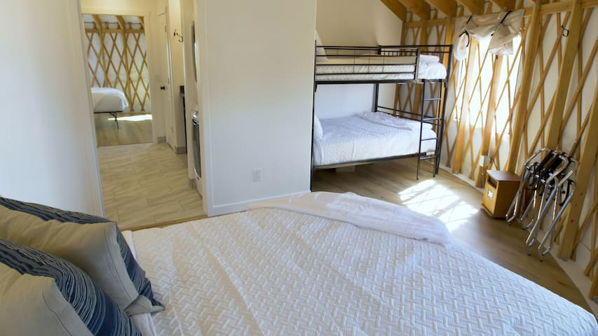 Queen Size bed area with Full on Full bunk bed area for comfortable sleeping arrangements