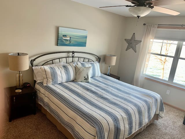 Upper level bedroom with king size bed. All new furnishings.