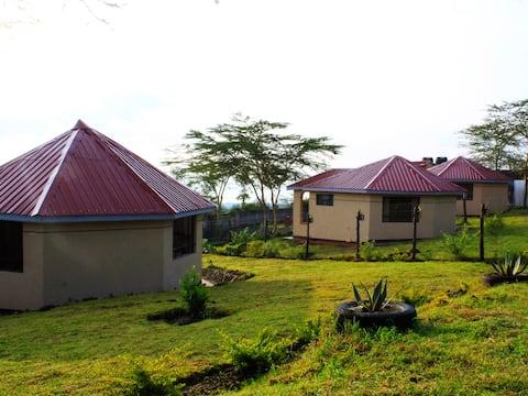 Modern Rondavels with clear views of Lake Nakuru.