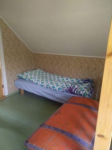 Single bed on upstairs landing.
