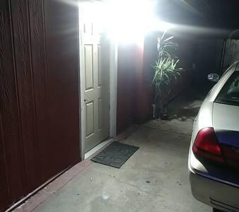 Motion sensor security lighting, private access door with 24/7 electronic door lock access code