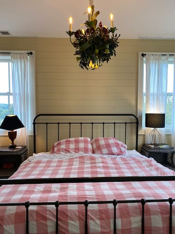 The ground floor has a master bedroom with a king bed and en suite bathroom.