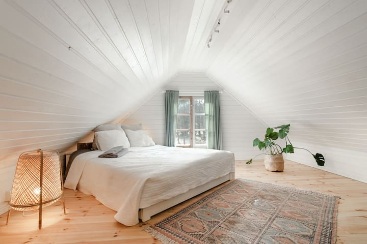 The charming upstairs king bedroom