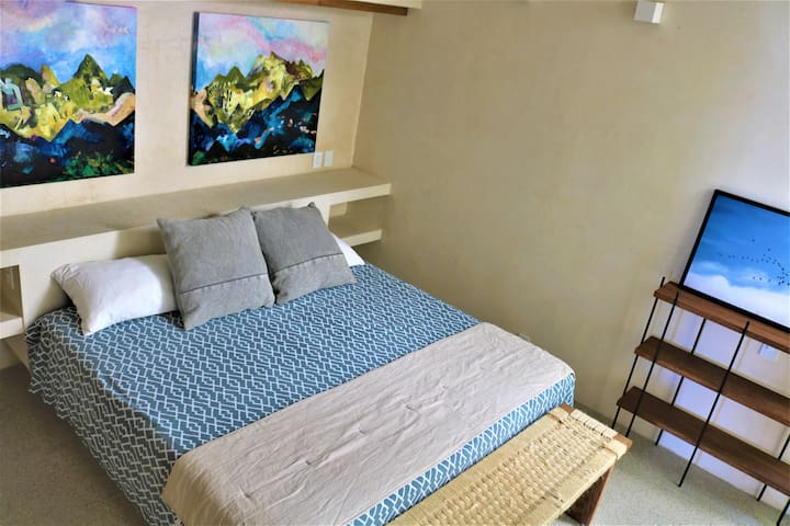 Master bedroom offers an en suite bath with modern touches and plenty of storage.