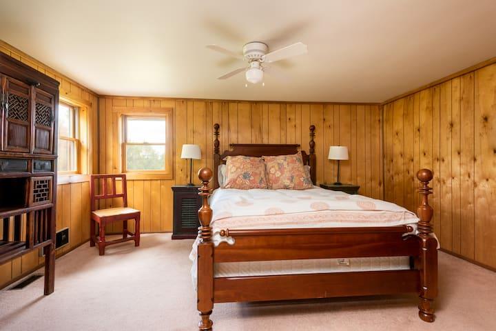 First floor bedroom with a queen bed.