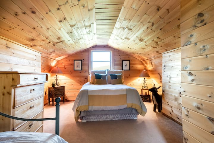 Bedroom in the loft area includes a double bed and a day bed.