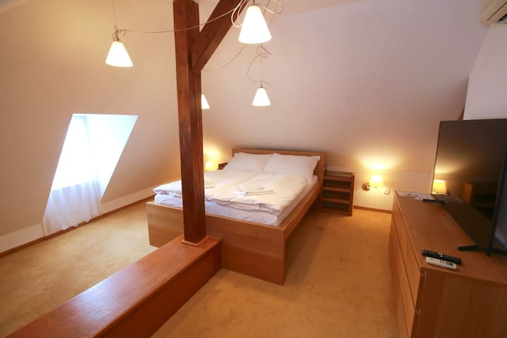 Attic apartment next to the Old town square