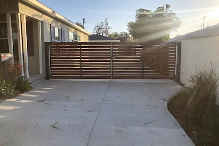 Enter through the gate and walk up the driveway.