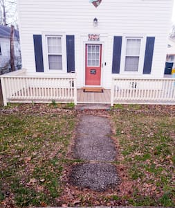 There is a street light to the left and behind the camera which, when combined with the front entrance deck light, illuminates the entire walk sufficiently. If a Guest raises a concern, solar-powered sidewalk marker lights can be installed.