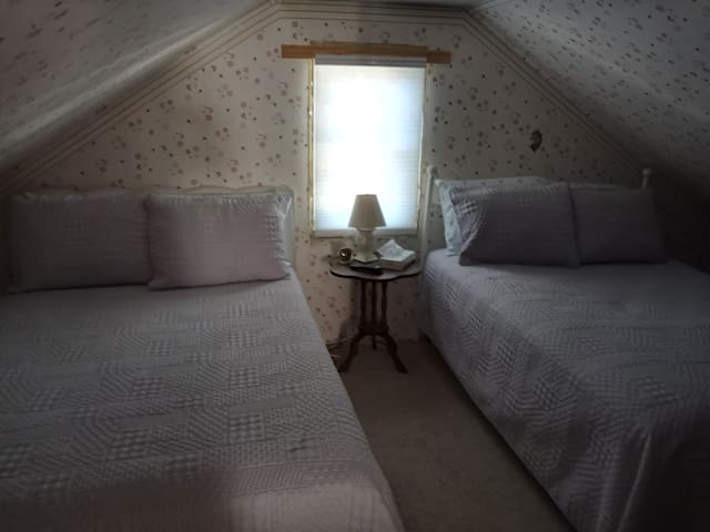 Gray West Loft room with two Full beds.