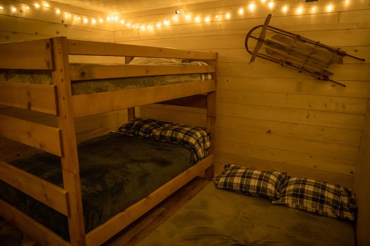 the ski bums bunk house with the trundle out