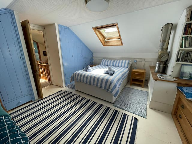 Bedroom 2 has a standard double and a single bed.