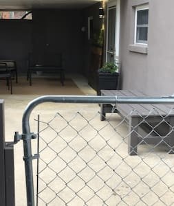 After you park, you will walk through this gate and to your entrance door on the right. Behind you in this shot is a security light  illuminating your walk in.  There is also an outdoor fixture on the wall by the door and a lamp in the patio area!