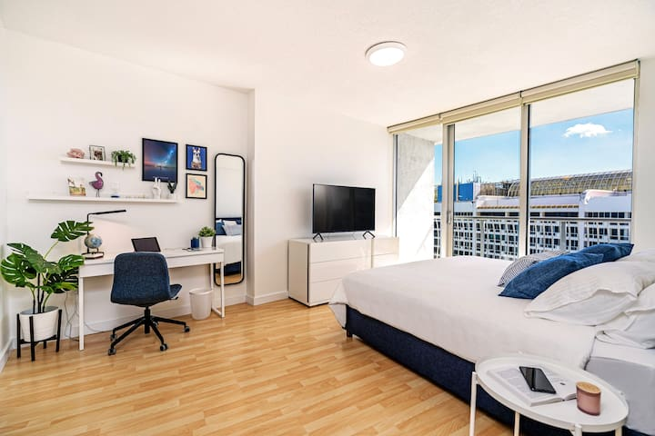 """Bedroom - Here for work o vacay, you've got plenty of comfortable space for both. King size bed with memory foam mattress + a 55"""" curved TV with Netflix. High speed internet, some notepads, pens and a comfortable chair. That's all you need!"""