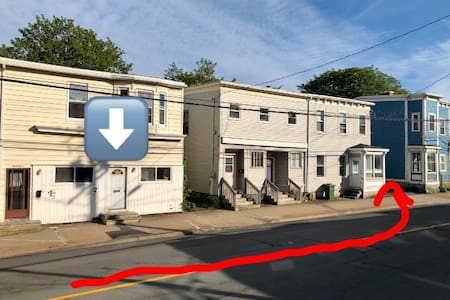 First arrow shows the door to the apartment, red arrow leads to the parking lot