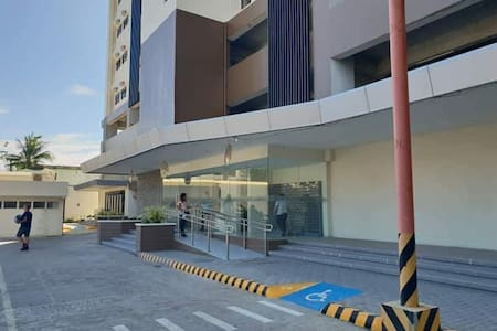 The main entrance of the building has ramp on the side as shown in photo aside from the stairs in front.