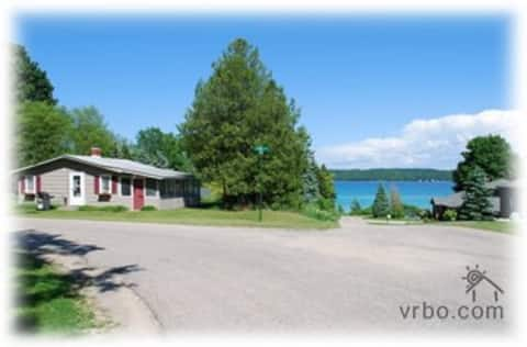 Torch Lake Village Cozy Cottage with private dock.