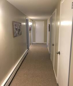 Large wide hallway. All bedrooms are on the same level as the common spaces.