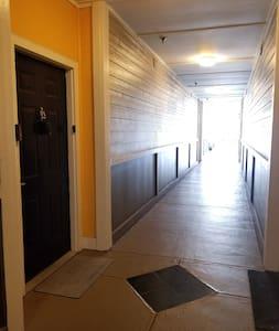 Very wide breezeway leading to the suite door. Doorway measures 36 inches wide.