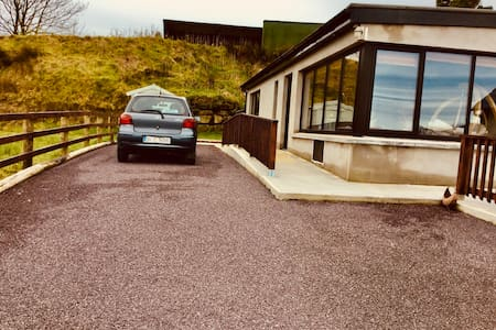 Single storey building easily accessed from wide parking spaces.
