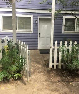 "46"" wide fence, 34"" wide door, very mild upslope from the sidewalk."