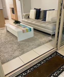 A very small step over the sliding door frame and a very wide entry exist through the sliding door through the verandah/ esplanade entrance.