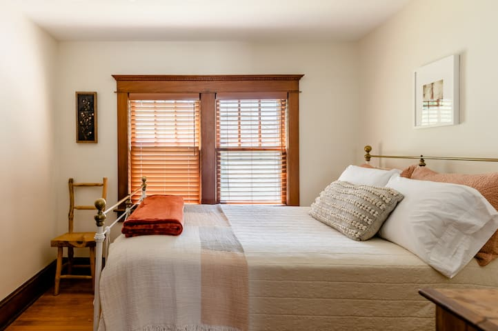 This bedroom upstairs features a full-size antique brass bed. The sheets are 100% cotton throughout the house.
