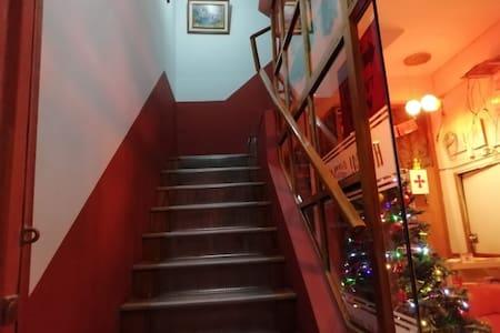 Subir escaleras en 2 tramos.