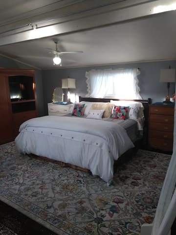Master King Bedroom with Chaise for reading, TV/DVD combo, extra pillows and duvet for a night of rest.....