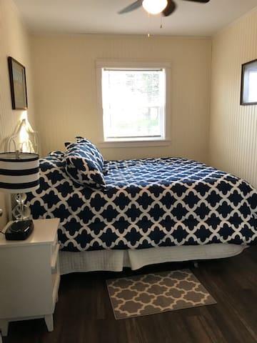 main floor bedroom with queen size bed