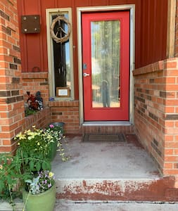 Motion detectors at front door and 2 on each side of the driveway. There are 3 wide steps approaching the door.