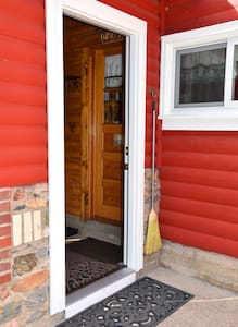 A 32-inch entry door leads to the enclosed porch and is four inches higher than the outside concrete approach. A second 32-inch door requires a 9-inch step-up from the enclosed porch into the kitchen.