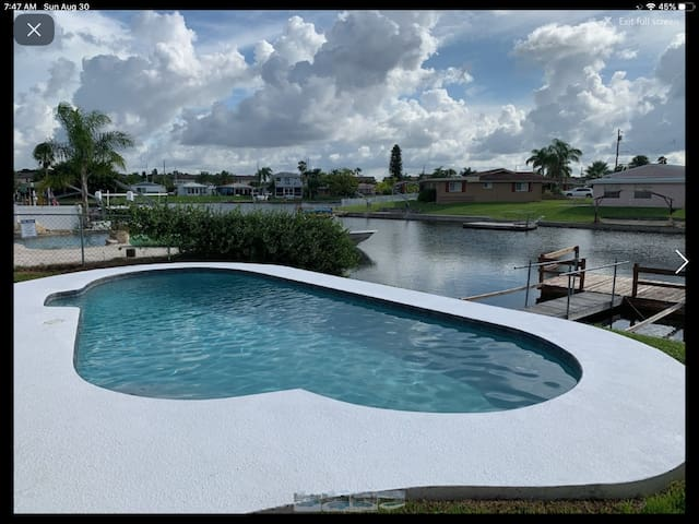 Vacation home w/ pool & dock in Gulf Harbors