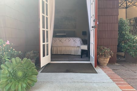 """The entrance to the guest house consists of French Doors that are well over 32"""" wide."""