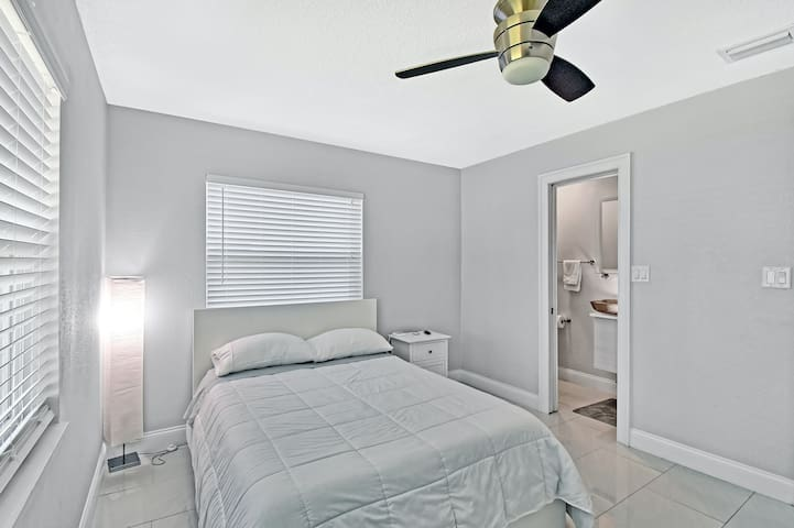 Master Bedroom with small modern full bathroom.