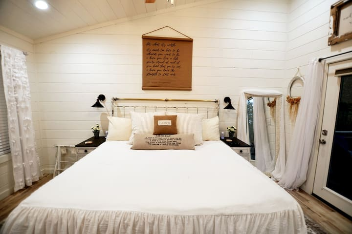 A king size bed and lots of comfy farmhouse details.