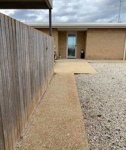 Easy access level concrete paths from parking space