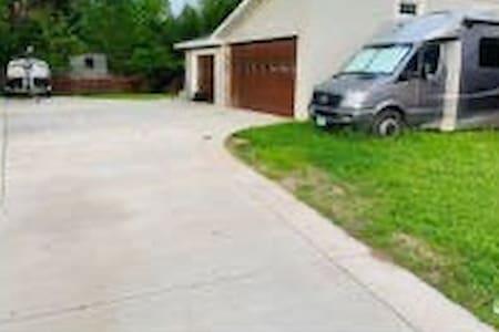 Concrete driveway, indoor garage parking, no steps