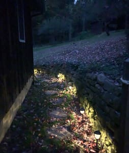 Follow the lighted pathway from the parking pad to the back deck for the entrance to the Cabin.