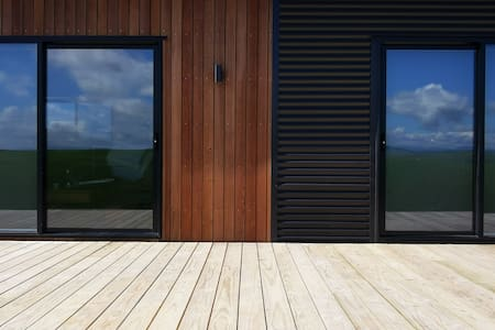 2 sliding doors give entrance to the house