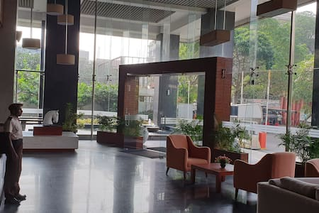 Wide entrance as you come into the lobby area which leads you to the elevators