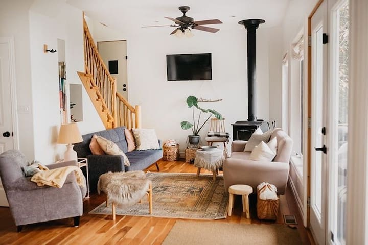 Lay the blue sofa bed down and enjoy a movie night indoors! We provide guest access for Netflix and Amazon Prime!   @rejeannemartin