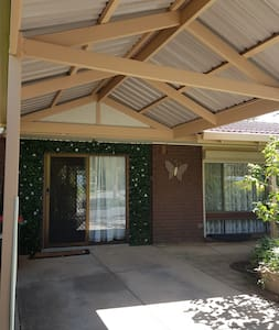sliding glass door just a few steps from your carport